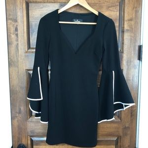 Lulu's Black Dress with a White Trim Bell Sleeve